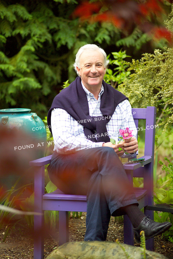 British clematis expert, Raymond Evison, of the Guernsey Clematis Nursery, sits in the garden.