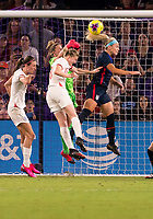 5th March 2020, Orlando, Florida, USA;  the United States midfielder Julie Ertz (8) defends a corner as the goalkeeper Alyssa Naeher (1) goes to punch clear during the Women's SheBelieves Cup soccer match between the USA and England on March 5, 2020 at Exploria Stadium in Orlando, FL.