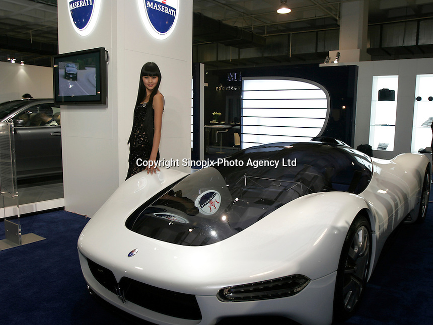 A model stands beside a silver Maserati at The Beijing International Automobile Exhibition..19 Nov 2006