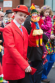 Covent Garden, London, UK. 11 May 2014. The festival starts with a procession around the streets of Covent Garden. Young puppeteers. The Covent Garden May Fayre and Puppet Festival takes place at St Paul's Church.