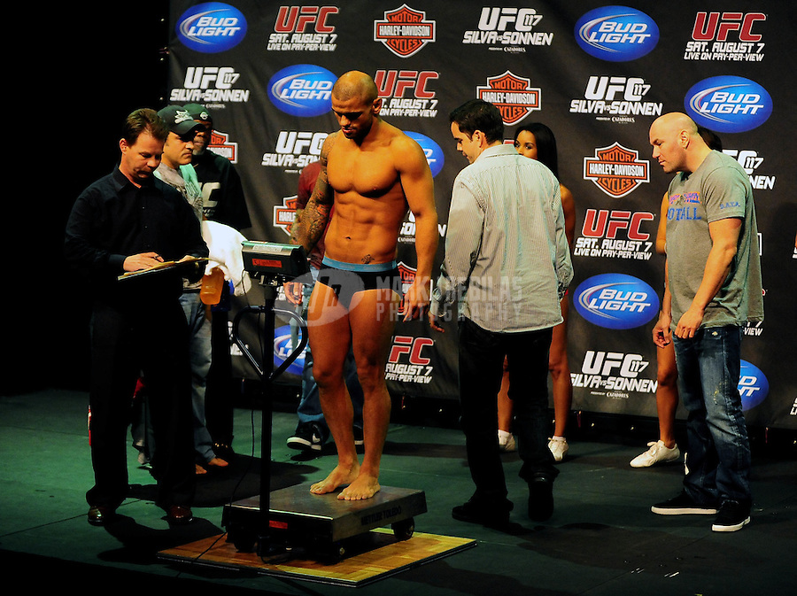 Aug. 6, 2010; Oakland, CA, USA; UFC president Dana White (right) looks on as catchweight bout fighter Thiago Alves weigh ins a half pound overweight for UFC 117 at the Oracle Arena. Mandatory Credit: Mark J. Rebilas