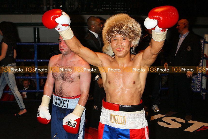 Choi Tseveenpurev (red/blue shorts) defeats Mickey Coveney in a Featherweight Boxing contest at York Hall, Bethnal Green, promoted by Hard Knocks / Spencer Fearon - 04/06/10 - MANDATORY CREDIT: Gavin Ellis/TGSPHOTO - Self billing applies where appropriate - Tel: 0845 094 6026