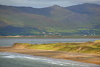 Horses and riders round the bend at the far end of the track on Rossbeigh Strand in County Kerry. Photo: Don MacMonagle