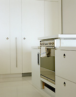 A minimal kitchen with a bespoke cooker that can be adjusted to a comfortable height for whoever is cooking