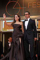 ANGELINA JOLIE &amp; BRAD PITT<br /> 'The Tree of Life' premiere at the Palais des Festival, 64th International Cannes Film Festival, France<br /> 16th May 2011<br /> full length strapless silk satin brown dress gown black tux tuxedo tinted glasses sunglasses shades couple gathered slit split goatee facial hair hand arm waving<br /> CAP/PL<br /> &copy;Phil Loftus/Capital Pictures /MediaPunch ***NORTH AND SOUTH AMERICAS ONLY***