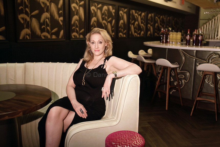 Amy Sacco, brand creator of the new nightclub No. 8 in Chelsea, poses for a portrait at the venue. ..Danny Ghitis for The New York Times