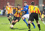 Partick Thistle v St Johnstone....21.01.14   SPFL<br /> James Craigen holds off David Wotherspoon<br /> Picture by Graeme Hart.<br /> Copyright Perthshire Picture Agency<br /> Tel: 01738 623350  Mobile: 07990 594431