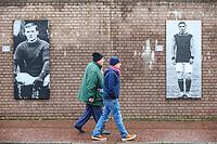 Burnley fans walk past pictures of former players, outside Turf Moor<br /> <br /> Photographer Alex Dodd/CameraSport<br /> <br /> The Premier League - Burnley v West Ham United - Sunday 30th December 2018 - Turf Moor - Burnley<br /> <br /> World Copyright © 2018 CameraSport. All rights reserved. 43 Linden Ave. Countesthorpe. Leicester. England. LE8 5PG - Tel: +44 (0) 116 277 4147 - admin@camerasport.com - www.camerasport.com