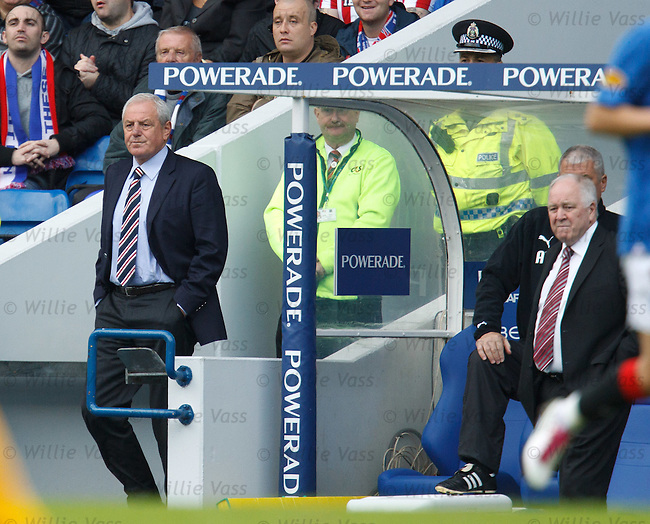 Walter Smith walks down the tunnel from his seat in the directors box to give Ally McCoist some instructions