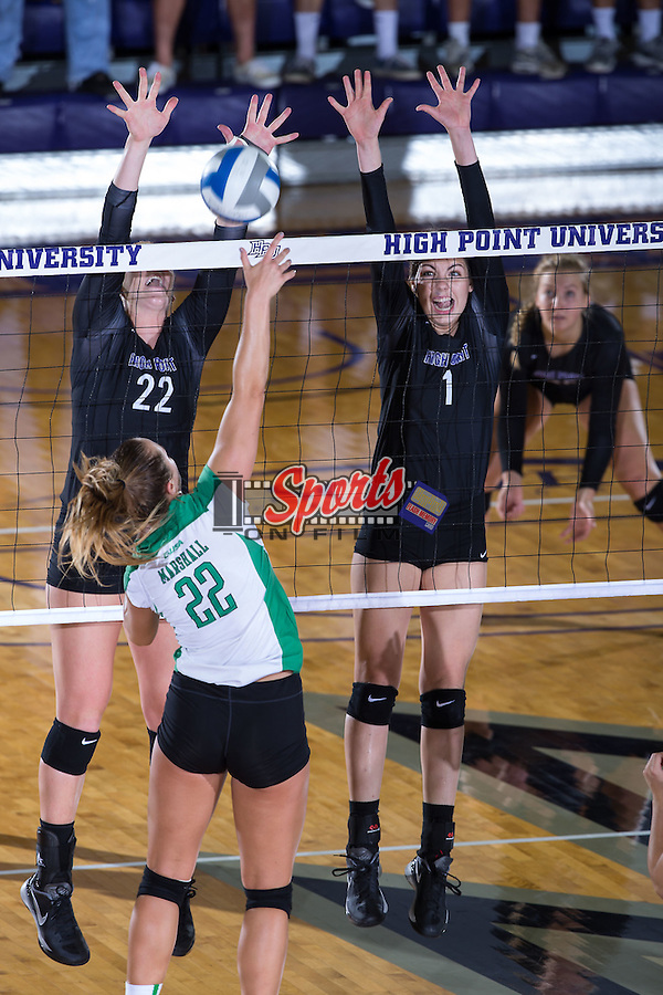 Jordan Hefner (1) and Molly Livingston (22) of the High Point Panthers attempt to block an attack from Cassie Weaver (22) of the Marshall Thundering Herd at the Panther Invitational at the Millis Athletic Center on September 12, 2015 in High Point, North Carolina.  The Thundering Herd defeated the Panthers 3-2.   (Brian Westerholt/Sports On Film)