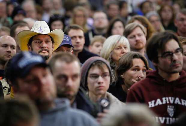 Potential caucus goers listen while Ron Paul speaks during a campaign stop in Des Moines on December 28.