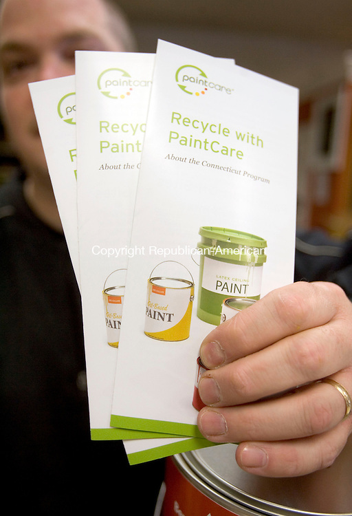 WATERBURY CT. 10 May 2013-051013S14-Chris Carrafiello, paint manager, at Bushka Lumber holds some of the pamphlets he hands out to customers about recycling at Bushka in Waterbury Friday. The state is launching a paint-recycling program. .Steven Valenti Republican-American