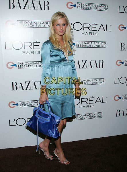 NICKY HILTON.L?Oreal Paris® Presents the ?As Seen In? Harper?s Bazaar? event to benefit the Ovarian Cancer Research Fund held at The Lindbrook Gallery in Westwood, California  .December 8th,2005.Ref: DVS.full length blue silk satin dress bag purse.www.capitalpictures.com.sales@capitalpictures.com.Supplied By Capital PIctures