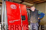 Terence O'Sullivan Carker Scartaglen with the robot that is milking his cows