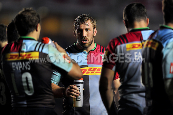 Chris Robshaw of Harlequins speaks to his team-mates during a break in play. Aviva Premiership match, between Harlequins and Sale Sharks on November 6, 2015 at the Twickenham Stoop in London, England. Photo by: Patrick Khachfe / Onside Images
