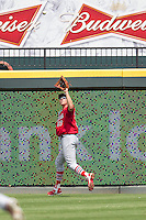 Memphis Redbirds outfielder Stephen Piscotty #33 makes a catch during the Pacific Coast League baseball game against the Round Rock Express on April 27, 2014 at the Dell Diamond in Round Rock, Texas. The Express defeated the Redbirds 6-2. (Andrew Woolley/Four Seam Images)