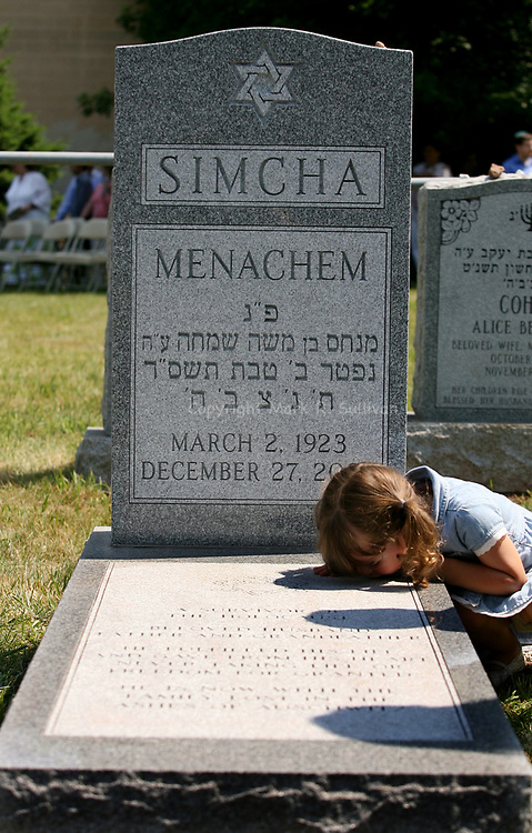 "Haley Larsen, age 3 of North Brunswick leans down to kiss the grave stone of her great grand father Memachem ""Opa"" Simcha at the Etz Ahaim Cemetery in New Brunswick. As the cemetery was being rededicated today after being vandalized back in January.<br /> <br /> <br /> METRO<br /> 2448<br /> ON SUN JUNE 29,2008<br /> MARK R. SULLIVAN/CHIEF PHOTOGRAPHER"