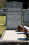 Haley Larsen, age 3 of North Brunswick leans down to kiss the grave stone of her great grand father Memachem &quot;Opa&quot; Simcha at the Etz Ahaim Cemetery in New Brunswick. As the cemetery was being rededicated today after being vandalized back in January.<br /> <br /> <br /> METRO<br /> 2448<br /> ON SUN JUNE 29,2008<br /> MARK R. SULLIVAN/CHIEF PHOTOGRAPHER
