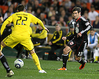 Chris Pontious#13 of D.C. United sends the ball past Dejan Rusmir#22 of the Columbus Crew during the opening match of the 2011 season at RFK Stadium, in Washington D.C. on March 19 2011.D.C. United won 3-1.