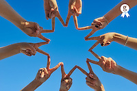 Ten hands drawing a star shape, close-up (Licence this image exclusively with Getty: http://www.gettyimages.com/detail/105765531 )