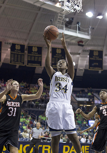November 20, 2012:  Notre Dame forward Markisha Wright (34) goes up for a shot as Mercer forward Kate Alemann (31) defends during NCAA Women's Basketball game action between the Notre Dame Fighting Irish and the Mercer Bears at Purcell Pavilion at the Joyce Center in South Bend, Indiana.  Notre Dame defeated Mercer 93-36.