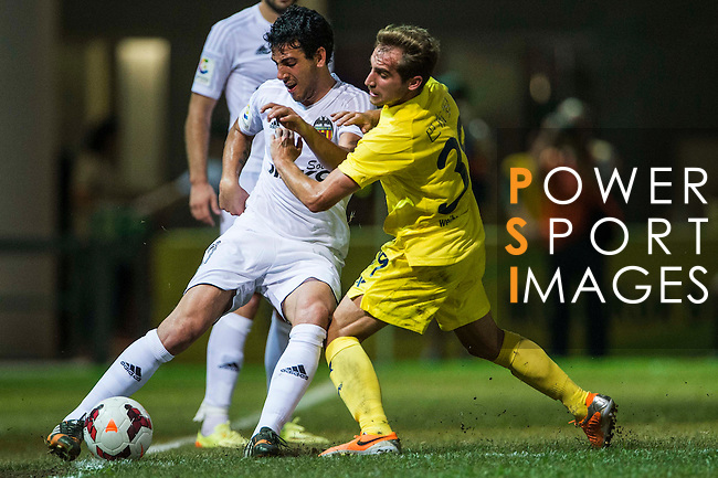 (L) Daniel Parejo of Valencia CF competes for the ball during LFP World Challenge 2014 between Valencia CF vs Villarreal CF on May 28, 2014 at the Mongkok Stadium in Hong Kong, China. Photo by Victor Fraile / Power Sport Images