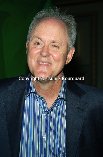 John Lithgow arriving at the NBC tca (Television critic Association) All Star pary at the Ritz Carlton In Los Angeles. July 22, 2006.<br /> eye contact<br /> headshot