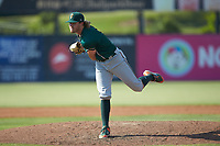 Greensboro Grasshoppers relief pitcher Braeden Ogle (14) follows through on his delivery against the Piedmont Boll Weevils at Kannapolis Intimidators Stadium on June 16, 2019 in Kannapolis, North Carolina. The Grasshoppers defeated the Boll Weevils 5-2. (Brian Westerholt/Four Seam Images)