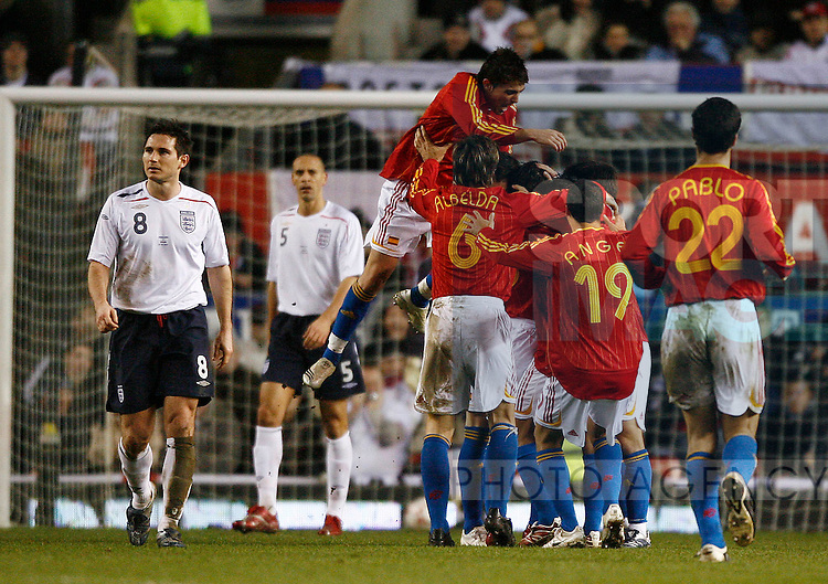 Spain celebrate the winning goal watched England's Frank Lampard