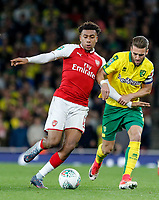 Alex Iwobi of Arsenal battles Ivo Pinto of Norwich City during the Carabao Cup match between Arsenal and Norwich City at the Emirates Stadium, London, England on 24 October 2017. Photo by Carlton Myrie.