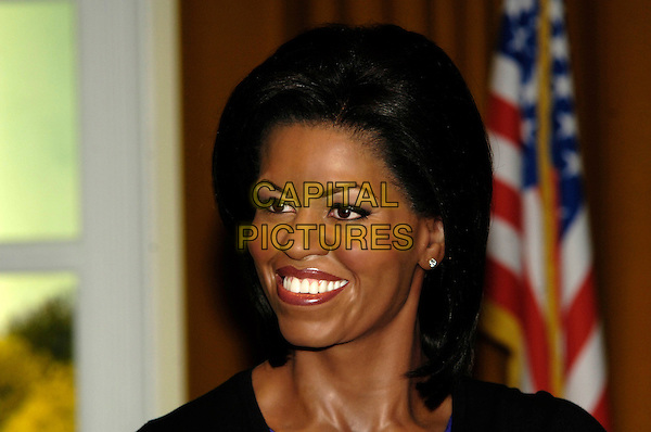 MICHELLE OBAMA WAXWORK.New waxworks are unveiled of Michelle and Barack Obama at Madame Tussauds, London, England..January 19th, 2009.wax work politics headshot portrait first lady.CAP/CJ.©Chris Joseph/Capital Pictures.