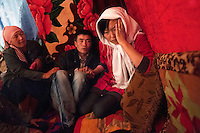 26 year old Tyhchtybek and an elderly female relative talk to 20 year old Farida at his home. He is trying to convince her to marry him after he abducted her from the street in Naryn. He says: 'I promise you that you will be happy in the future so please marry me' to which she replies: 'How come you kidnapped me. You know that I have a boyfriend. Even if I married you, there would be no love in our married life.' Although illegal, bride kidnapping is common in rural parts of Kyrgyzstan. Each year around 16, 000 women become married after being kidnapped. They are known as 'Ala Kachuu' that translates as 'to grab and run away'. Defenders of the continuation of the practice sight tradition. However, during Soviet Times it was rare, and parents generally arranged marriages...