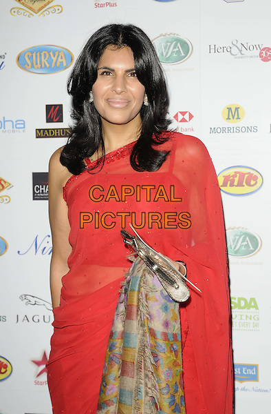 Anjum Anand .attended the World Food Awards 2011, Grosvenor House hotel, Park Lane, London, England, UK, 1st October 2011..half length red one shoulder sleeve dress sari .CAP/CAN.©Can Nguyen/Capital Pictures.