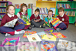 BOOKWORMS: Pupils of the new Scoil Iosagáin in Ballybunion checking out the library facilities at the brand new building on Friday, l-r: Leah Nagle, Katie McAuliffe, Sean Walsh, Daithí Twomey, Darragh Hanrahan.