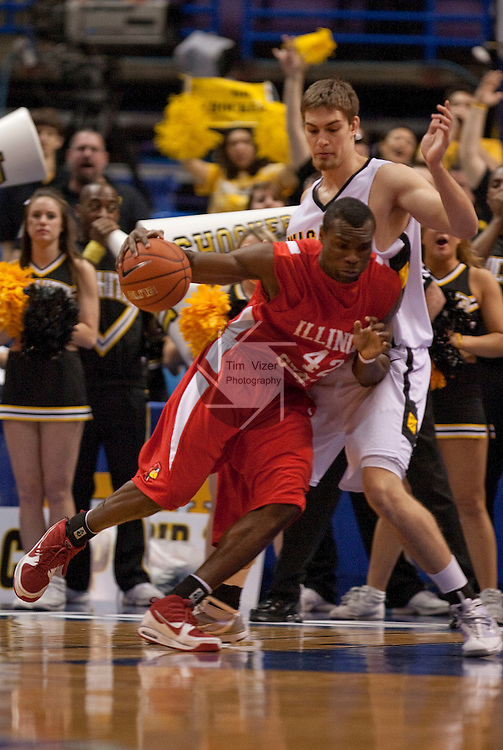 March 6,  2010           Illinois State forward Dinma Odiakosa (42) crashes into Wichita State center Garrett Stutz (41) in the first half as he tries to take the ball inside.   Wichita State defeated Illinois State by a score of 65-61 in the second of two semifinals played on Saturday March 6, 2010 at the Missouri Valley Conference Tournament.  The tournament is being held at the Scottrade Center in downtown St. Louis.  Wichita State advances to play the University of Northern Iowa for the MVC Tournament Championship.  The winner earns an automatic berth in the NCAA Tournament.