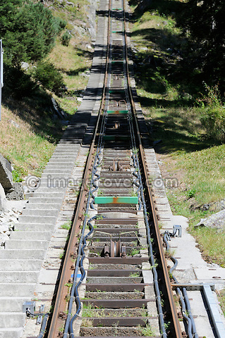 Switzerland, Western Europe, Grimsel region, nr. Guttannen. Gelmerbahn funicular railway. Track and pulling cable roller guides. Note: No releases available. --- Info: The Gelmer cable car funicular railway with a maximum incline of 106 percent is Europe's steepest cable car. The Gelmer Railway was built in the 1920s to help with the construction of the Lake Gelmer water reservoir dam. Originally used for freight the cable car was converted to a passenger railway in 2001. The 12 minutes and one kilometer long ride in the open carriages overcomes a 450 meters height difference and takes one up to Lake Gelmer at an altitude of 1860 meters above sea level. The region where the reservoir is located is the starting point for hikes and mountain tours.