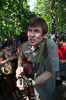 Moscow, Russia, 25/07/2010..A man sings songs by Vladimir Vysotsky as hundreds of Russians gather at the grave of the legendary bard singer, poet and actor  to mark the 30th anniversary of his death. Vysotsky, an alcoholic and heroin addict who died in 1980 aged 42 of a heart attack, is best known for his songs of Soviet prison and military life, and his acting on stage and screen. Much of his work was officially unpublished during his lifetime, and he remains a potent anti-authoritarian symbol of protest to Russians of all ages even today.