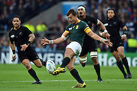 Handre Pollard of South Africa puts boot to ball. Rugby World Cup Semi Final between South Africa and New Zealand on October 24, 2015 at Twickenham Stadium in London, England. Photo by: Patrick Khachfe / Onside Images