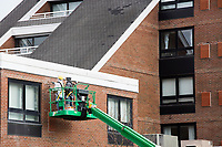 Workers repair brickwork on the exterior of Gurney's Newport Resort and Marina, which was formerly a Hyatt Regency hotel, on Goat Island in Newport, Rhode Island, on Wed., April 19, 2017. The exterior is being repaired and will soon be painted to give the hotel an updated look. The entire hotel will be renewed with an approximately $18 million renovation to be completed by Memorial Day 2017.