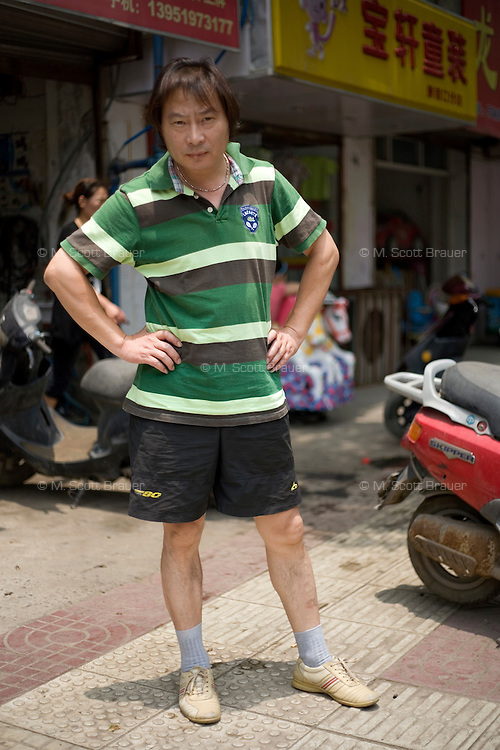 Fuyiming, a laborer, age 48, poses for a portrait in Nanjing. Response to 'What does China mean to you?': '[no answer]'  Response to 'What is your role in China's future? or What is China's role in the future?': '[no answer]'