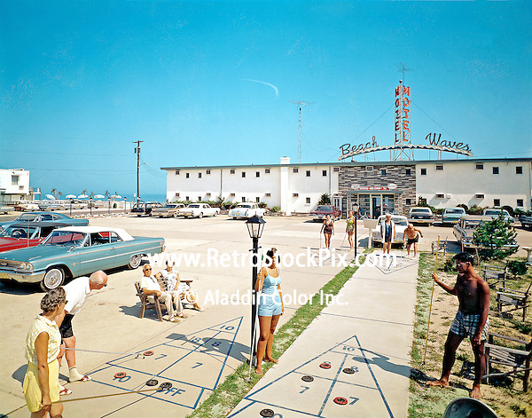 Beach Waves Motel in Wildwood New Jersey. Shuffleboard court in front of the motel. Old 1960's cars and fashion.