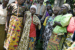 BUKAVU, DEMOCRATIC REPUBLIC OF CONGO - OCTOBER 31: Women and a girl wait to be attended to on October 31, 2007 outside a clinic in rural Bushushu, DRC. Many of the women visiting the clinic has been raped and abused by rebels and government soldiers. Today a Doctor and a nurse visit from Panzi hospital in Bukavu to interview and refer woman, if needed. The DRC conflict has seen an unprecedented high rate of rape and sexual abuse of women. The culprits are both different rebel groups and government soldiers and very few are punished. About 27,000 sexual assaults were reported in South Kivu province alone in 2006, according to the United Nations. (Photo by Per-Anders Pettersson)