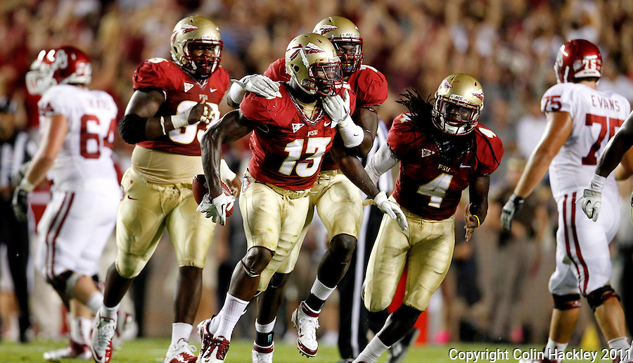 TALLAHASSEE, FL 9/17/11-FSU-OU091711 CH-Florida State's Nigel Bradham, center, celebrates intercepting an Oklahoma pass with Everett Dawkins, left, Christian Jones, and Terrance Parks, right, during first half action Saturday at Doak Campbell Stadium in Tallahassee. .COLIN HACKLEY PHOTO