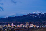 Downtown Reno, Nevada, skyline at sunrise with Mt. Rose ski resort, and Mt. Rose, snow capped mountains in the background.