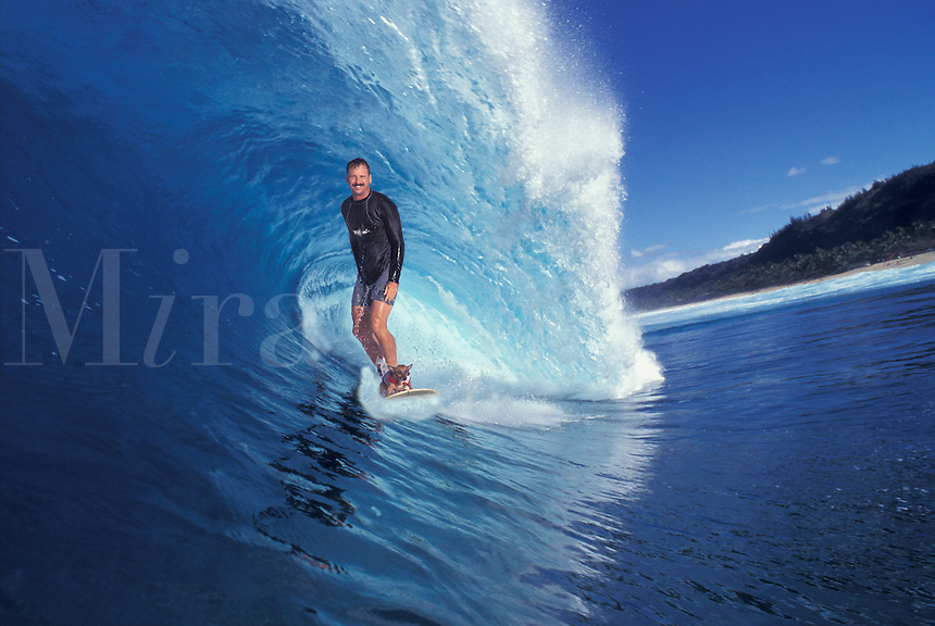 Hawaii, Oahu, North Shore, Backdoor Pipeline, surfer with dog.