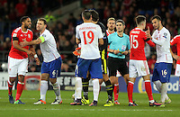 Ashley Williams of Wales (L) squares up against Vladimir Stojkovic of Serbia (C) who is held back by team mate Nikola Maksimovic during the 2018 FIFA World Cup Qualifier between Wales and Serbia at the Cardiff City Stadium, Wales, UK. Saturday 12 November 2016