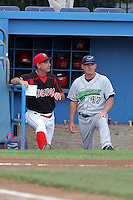 Batavia Muckdogs manager Dann Bilardello talks with Jammers Dave Berg before a game vs. the Jamestown Jammers at Dwyer Stadium in Batavia, New York July 18, 2010.   Batavia defeated Jamestown 6-1.  Photo By Mike Janes/Four Seam Images