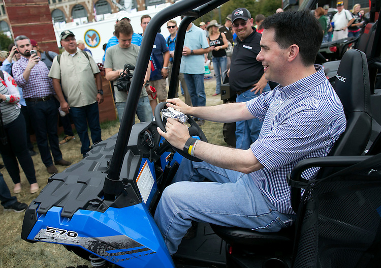 UNITED STATES - August 17: Governor of Wisconsin and Republican presidential candidate Scott Walker, sits in an All Terrain Vehicle while touring the midway at the Iowa State Fair in Des Moines, Iowa, Monday, August 17, 2015. (Photo By Al Drago/CQ Roll Call)