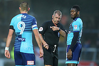 Referee, Mr Darren Handley, talks to Aaron Pierre of Wycombe Wanderers during the Sky Bet League 2 match between Wycombe Wanderers and Morecambe at Adams Park, High Wycombe, England on 12 November 2016. Photo by David Horn.