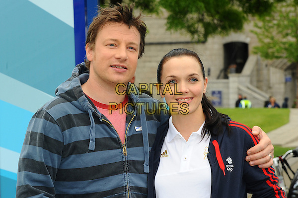 Jamie Oliver and Victoria Pendleton.The Samsung Hope Relay Launch held at Potter's Field, Southbank,  London, England..May 14th, 2012.half length grey gray striped stripes top  maroon burgundy top white.CAP/CJ.©Chris Joseph/Capital Pictures.